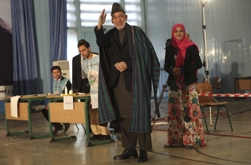 Afghan President Hamid Karzai prepares to vote at a high school near the presidential palace in Kabul on Saturday.