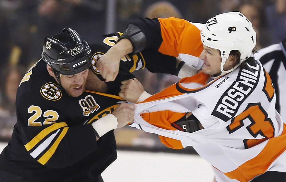 Shawn Thornton of the Bruins fights with Philadelphia's Jay Rosehill in the first period Saturday at Boston.