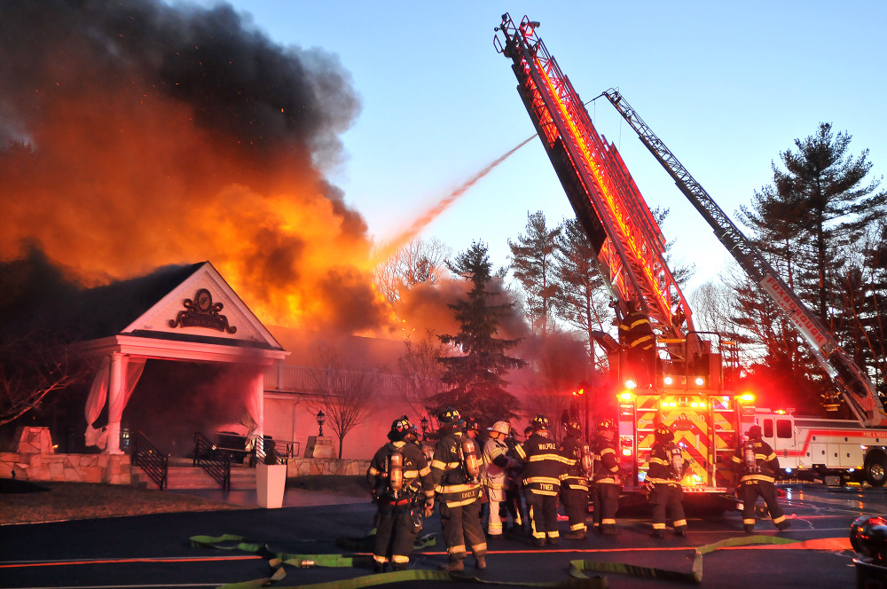 Firefighters respond to a multiple alarm fire at the popular Lakeview Pavilion in Foxboro, Mass., on Saturday.