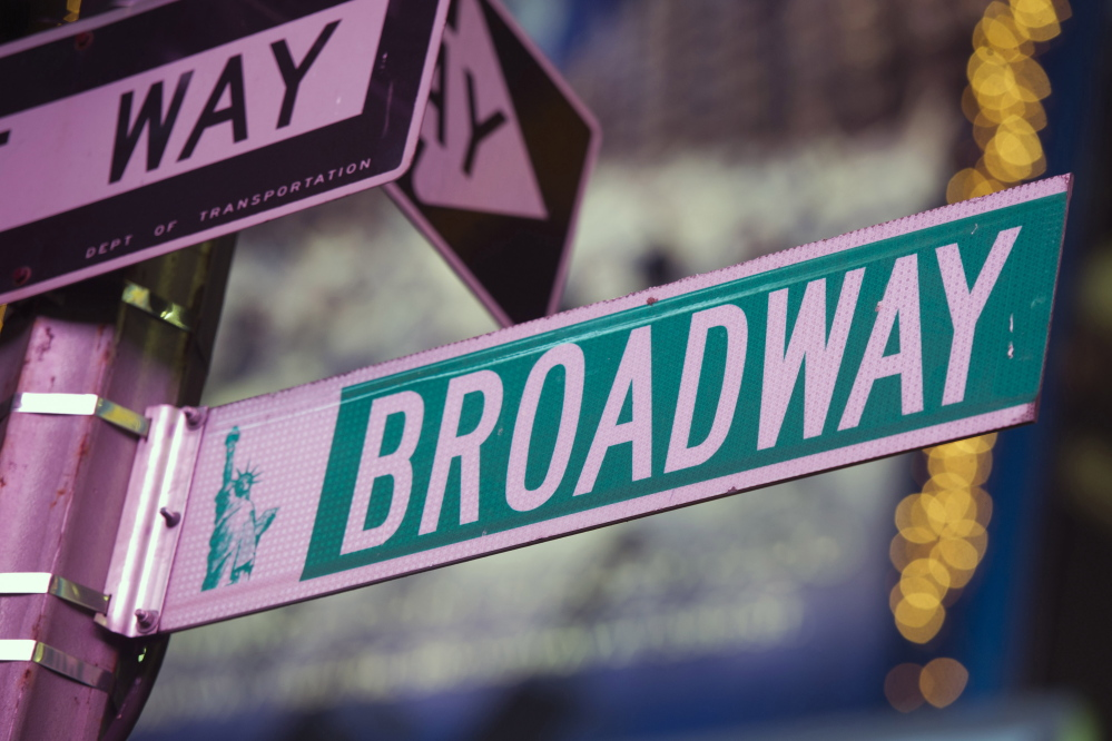 A street sign in Times Square marks Broadway in New York City. A proposed change in the federal tax code would allow live theater investment to be deducted up to $15 million per production.
