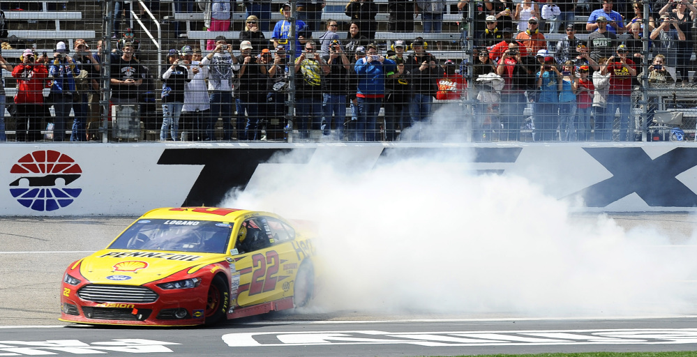 NICE WIN: Joey Logano burns his tires after winning the Duck Commander 500 on Monday at Texas Motor Speedway in Fort Worth, Texas.
