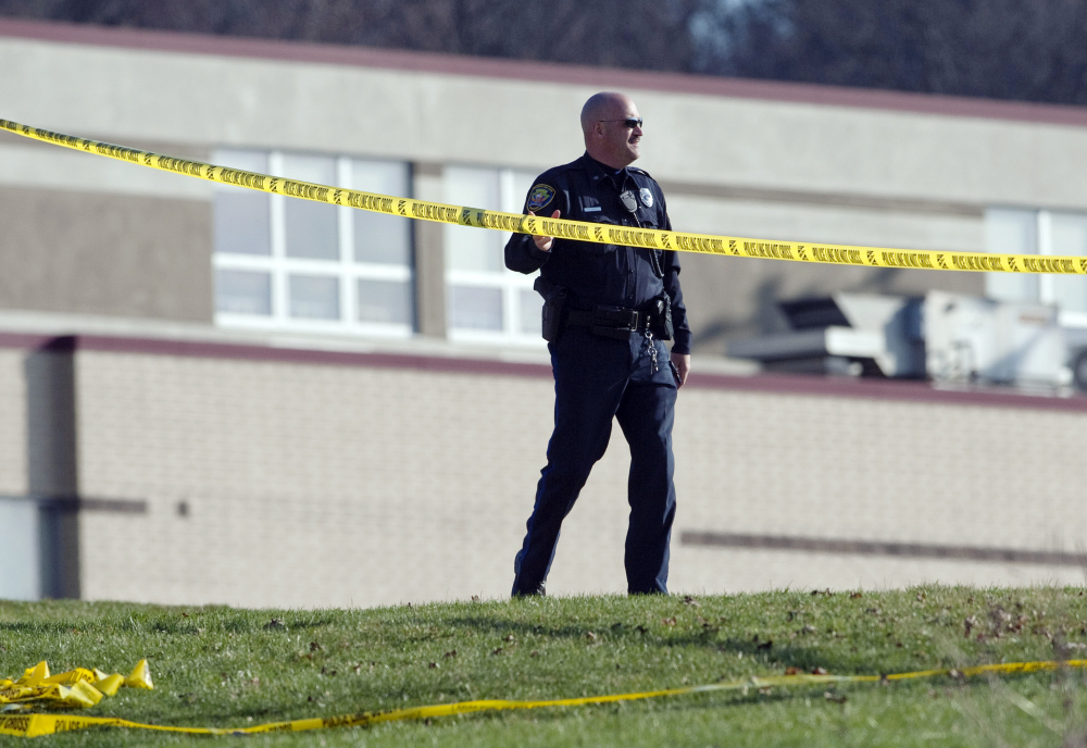 A police officer stands by the scene outside Franklin Regional High School where more then a dozen students were stabbed by a knife wielding suspect on Wednesday, April 9, 2014, in Murrysville, Pa., near Pittsburgh. The suspect, a male student, was taken into custody and is being questioned.
