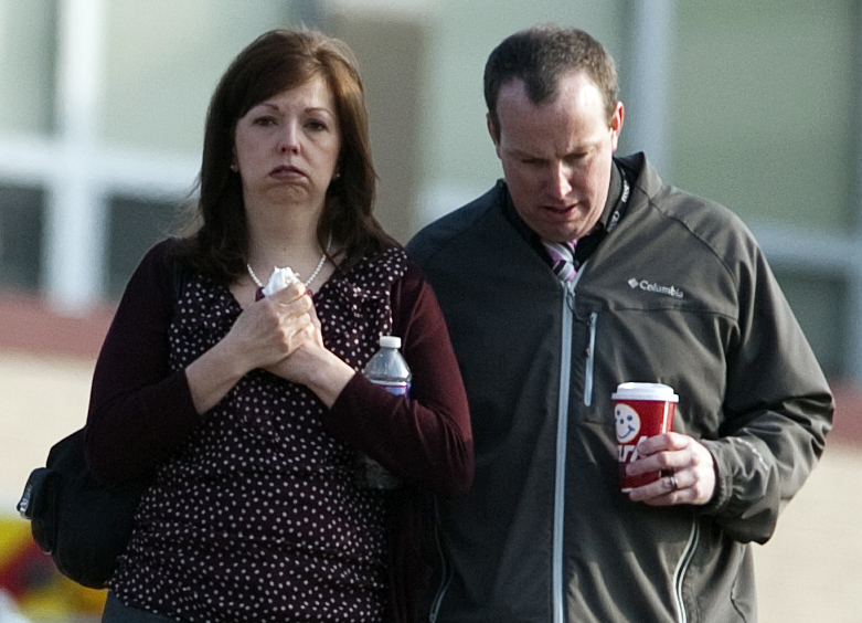 A man and woman walk away from Franklin Regional High School after more then a dozen students were stabbed by a knife wielding suspect at the school on Wednesday, April 9, 2014, in Murrysville, Pa., near Pittsburgh. The suspect, a male student, was taken into custody and is being questioned.