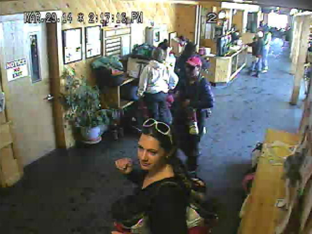 SUSPECT: The Franklin County Sheriff's Department released this photo showing a woman in the foreground who is suspected of stealing a backpack from Saddleback Mountain in Rangeley.