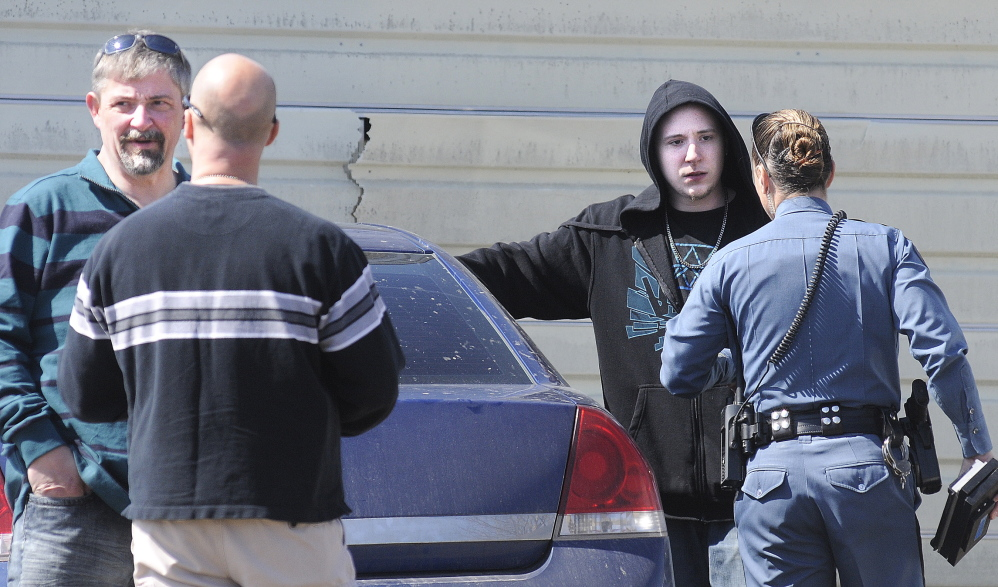 Questioning: Frederick Horne Sr., left, and Frederick Horne Jr. speak with Maine State Police officers on Thursday after being summoned on a charge of sex trafficking at their Sidney residence.