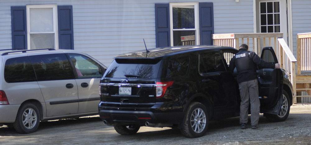 Evidence: Investigators collect evidence Thursday at a mobile home in Litchfield. Police summoned Gretchen Patrick, 51, of Augusta, on a charge of sex trafficking, saying she operated Sarah's Place, an escort service.