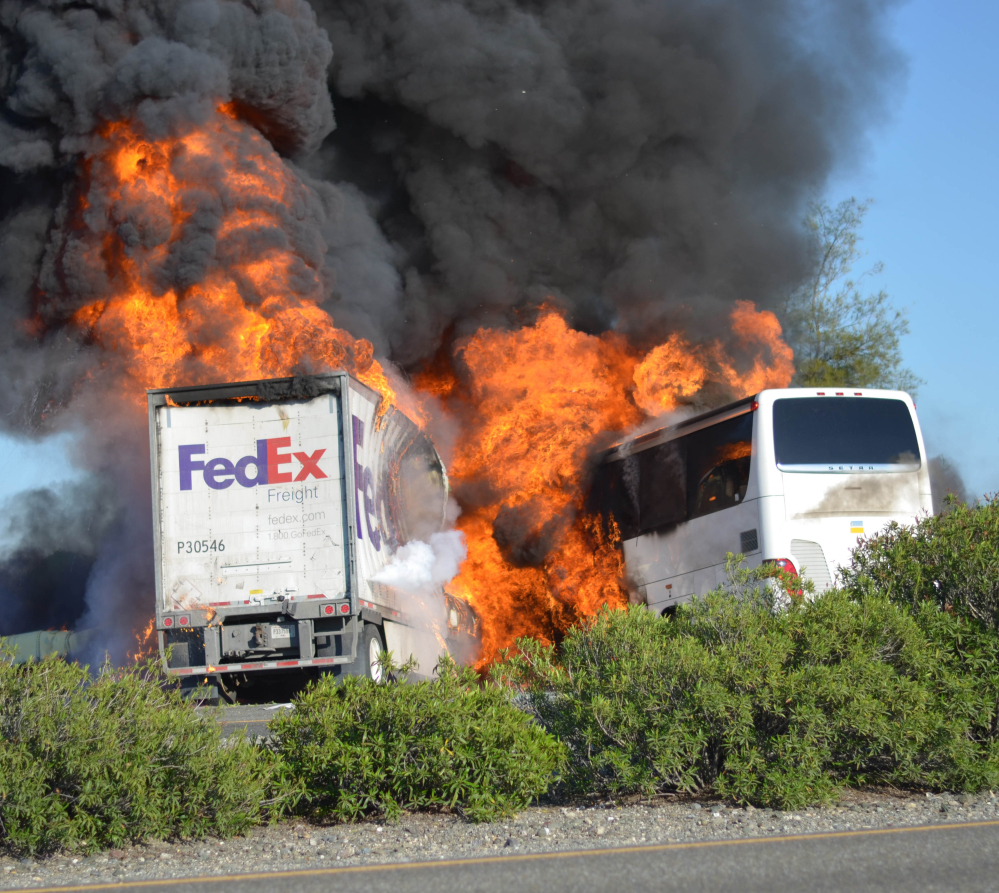 Massive flames engulfed a tractor-trailer and a tour bus just after they collided on Thursday near Orland, Calif.