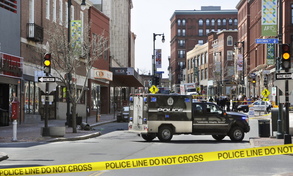 Congress Street in Portland is blocked as police bomb squad members dispose of a device used in a robbery Friday morning at the CVS drugstore at 510 Congress St.