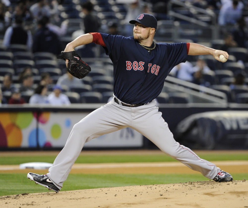 Boston Red Sox pitcher Jon Lester delivers the ball to the New York Yankees during the first inning of a baseball game Friday, April 11, 2014, at Yankee Stadium in New York.