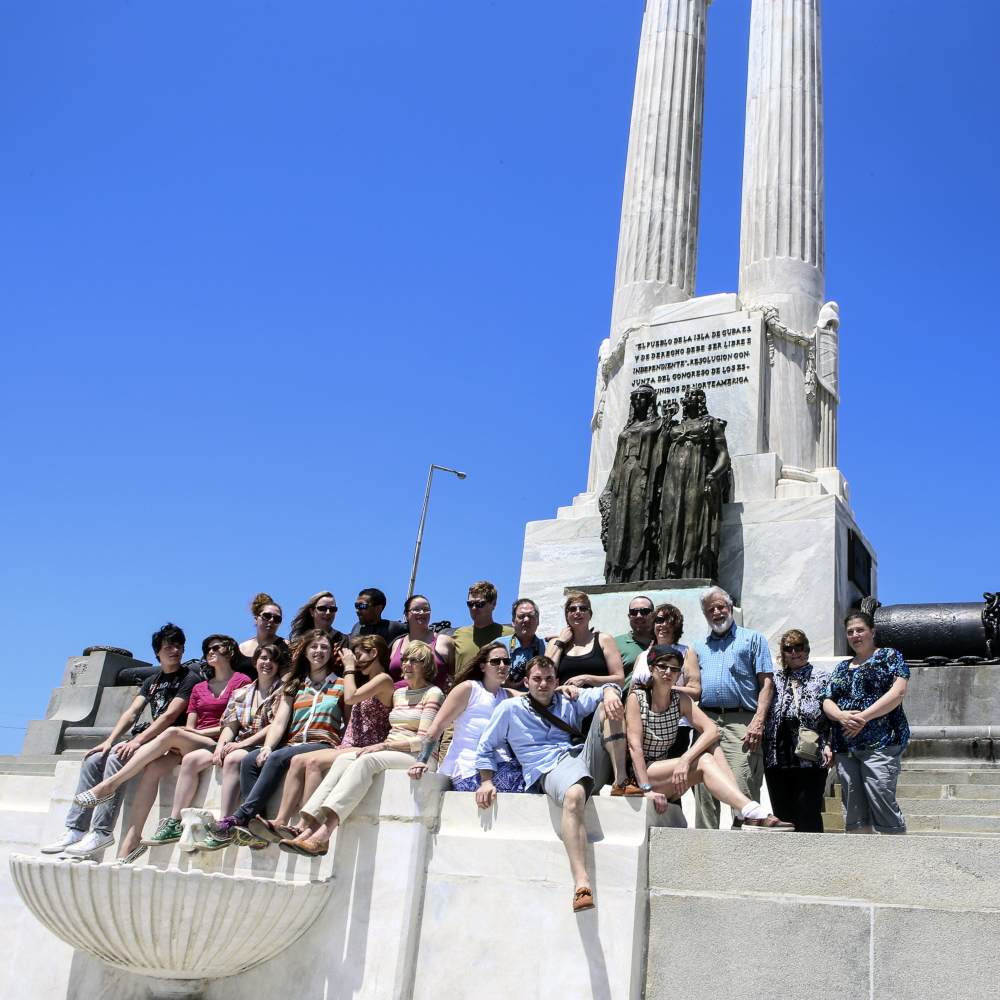Spanish-American War relic: University of Maine at Augusta students visit the USS Maine Memorial during their recent trip to Cuba.