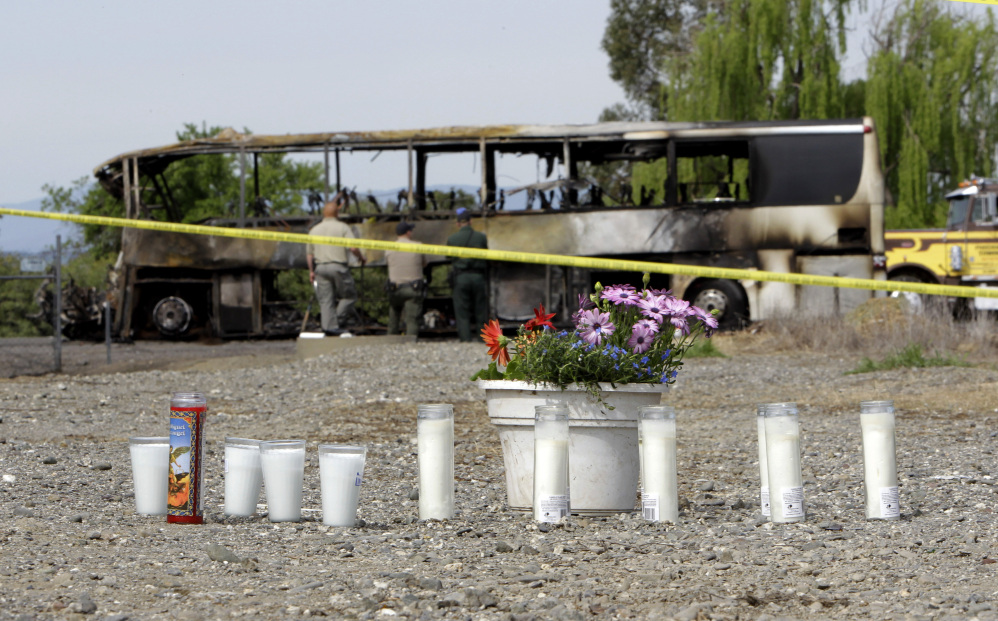 A makeshift memorial is created for the victims of an accident that included a tour bus and a FedEx truck on Interstate 5 in Orland, Calif.