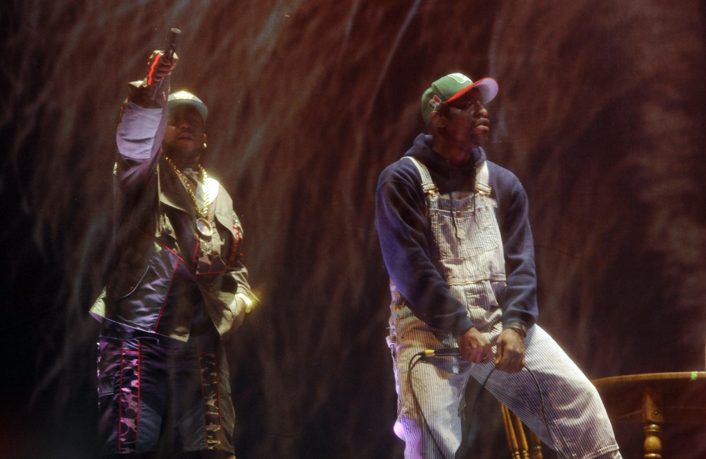 Big Boi, left, and Andre 3000 of Outkast perform behind a screen during their headlining set on the first day of the 2014 Coachella Music and Arts Festival on Friday in Indio, Calif.