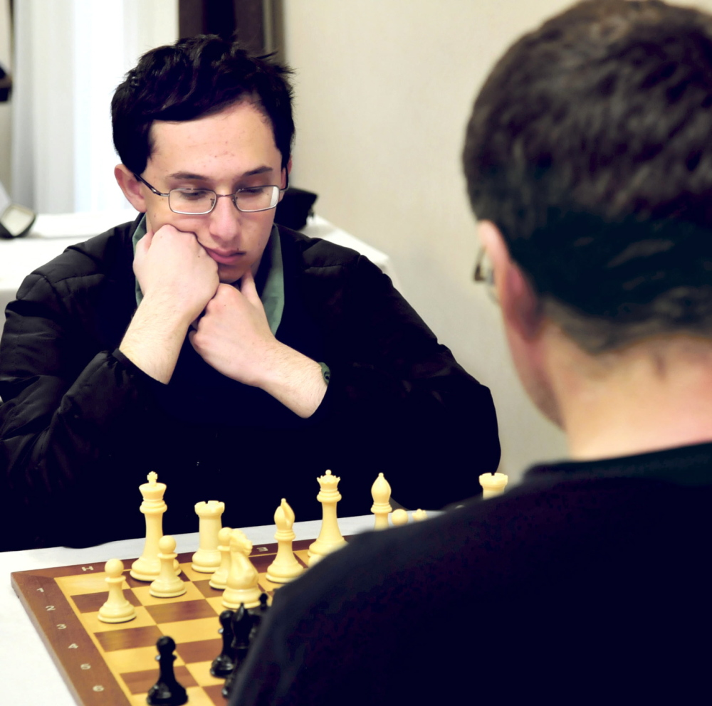 THE MASTERS: Master chess player Mathew Fishbein of Cape Elizabeth ponders his next move against fellow master Jarod Bryan of Augusta during the final match of the two-day Maine Closed Chess Championship in Waterville on Sunday. Bryan beat Fishbein to win his sixth championship.