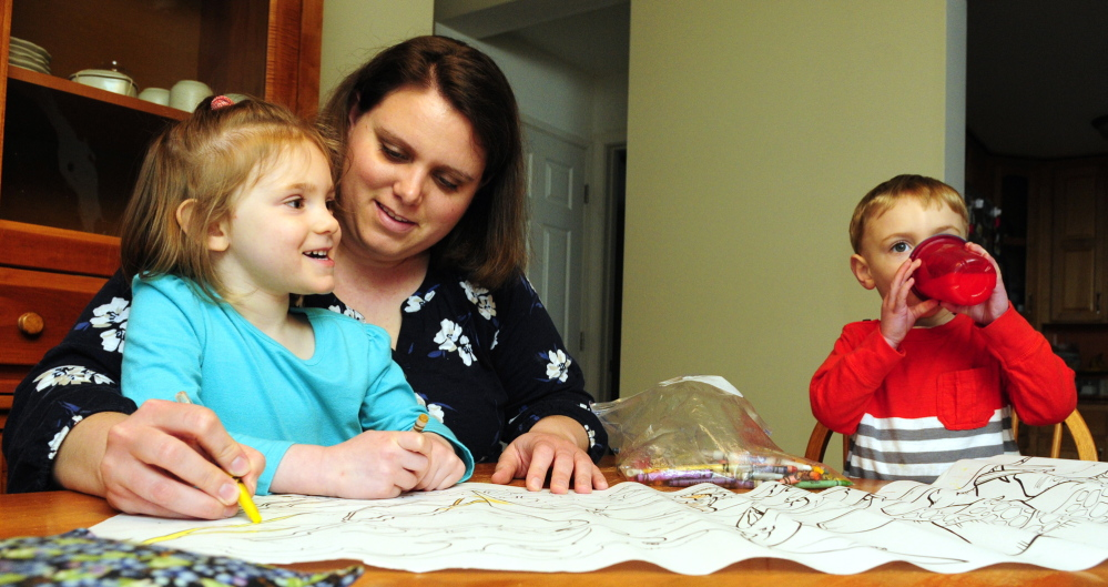 WELL TESTING: Emily Roderick colors with her children Annalise, 3, left, and Austin, 2, on Tuesday in Readfield. The family's home doesn't have arsenic in the well water but she's concerned about the issue.