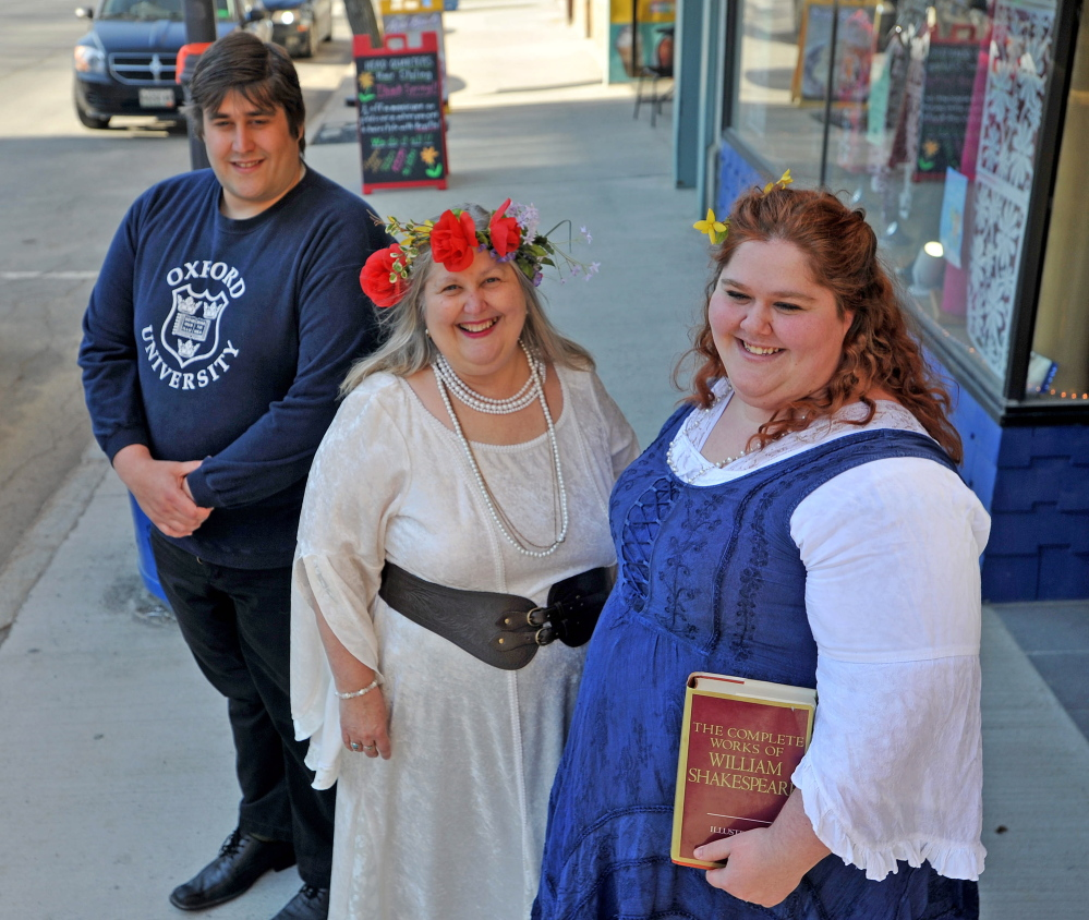 THE WORLD'S A STAGE: Lyn Rowden, center with her son Aaron, left, and Emily Rowden Fournier, right, stand on Main Street in downtown Waterville, where they will hold a 450th birthday party for Shakespeare on April 23, at which all of his 154 sonnets will be recited.