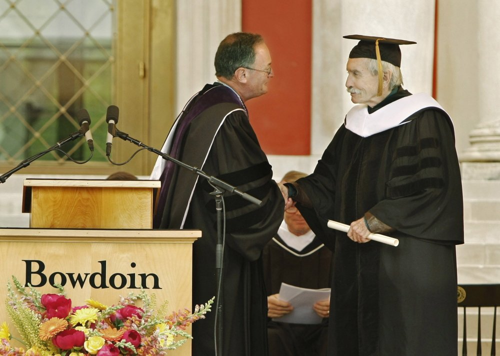 Barry Mills, left, president of Bowdoin College in Brunswick, congratulates playwright Edward Albee on receiving an honorary degree at the 204th commencement at Bowdoin College in Brunswick in 2009.
