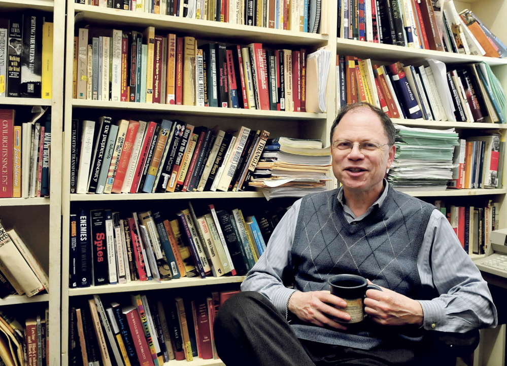 ACCESS: Colby College History Professor Robert Weisbrot in his office in Waterville on Monday, April 14, 2014. Weisbrot is concerned that access to hard copies of books may become a challenge as renovations begin in the college library. Weisbrot said the literature will be in storage which will limit its exposure to students and the public.