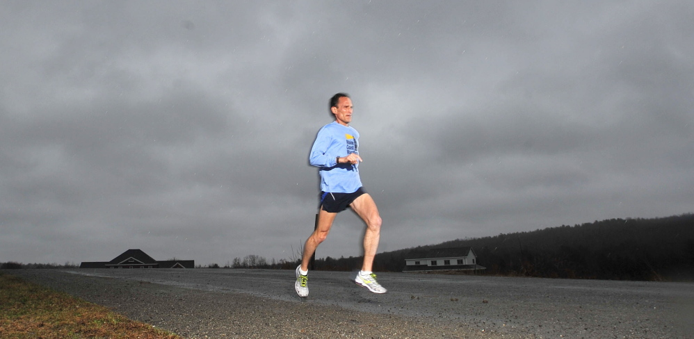 last days of training: Brian Morin of Waterville trains near his Stream View home in Waterville on Tuesday. Morin will be running the Boston Marathon on Monday.