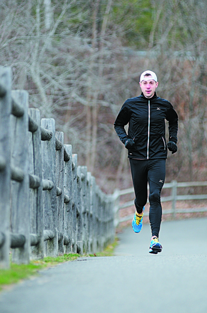 """BEFORE THE BOMBINGS: Seth Hasty runs on the Kennebec River Rail Trail in Gardiner last year, three days before he ran in the Boston Marathon. Hasty had finished the race and was at dinner when the bombs went off last year. He is running again this year. On the anniversary of the bombing Tuesday, he said that after last year, """"I couldn't wait to sign up."""""""
