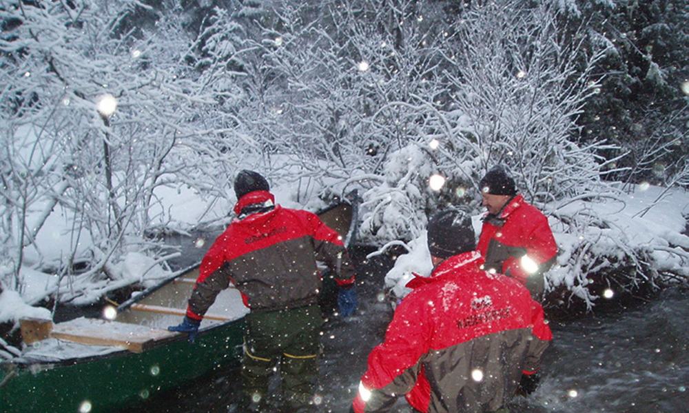 Maine wardens Gary Sibley, Ryan Fitzpatrick, and Alan Dudley are at work in Caswell on Tuesday night.