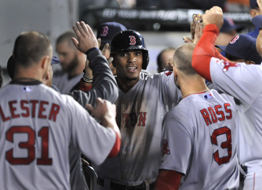 Xander Bogaerts celebrates with his Red Sox teammates in the dugout after hitting a solo home run in the sixth inning against the Chicago White Sox in Chicago on Thursday.
