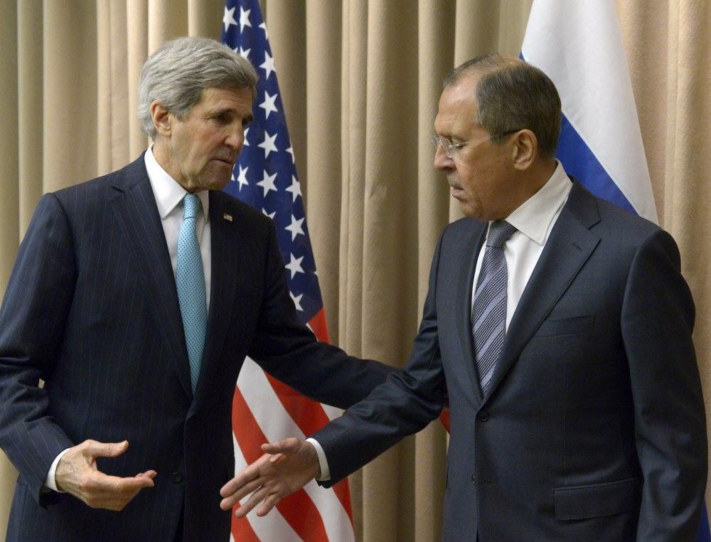 U.S. Secretary of State John Kerry, left, shakes hands with Russian Foreign Minister Sergey Lavrov before a bilateral meeting to discuss the ongoing situation in Ukraine as diplomats from the U.S., Ukraine, Russia and the European Union gather for discussions in Geneva.