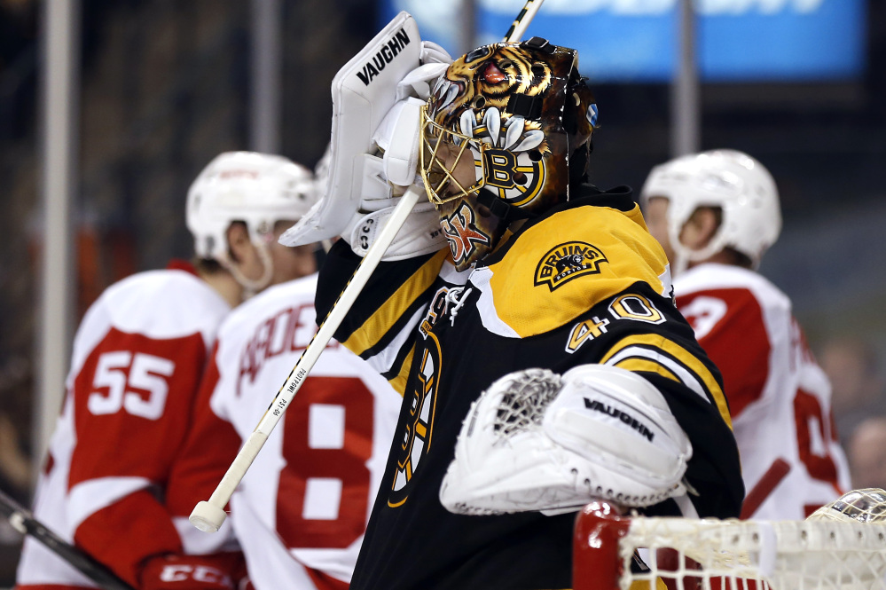 Boston Bruins goalie Tuukka Rask grimaces as Detroit Red Wings celebrate Pavel Datsyuk's goal during the third period of Detroit's 1-0 win in Game 1 of a first-round NHL playoff hockey game in Boston on Friday, April 18, 2014.