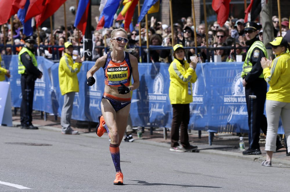 Home advantage: Shalane Flanagan approaches the finish line to finish fourth in the women's division of the Boston Marathon in Boston. Flanagan is more determined than ever to win the race for her battered hometown. The Marblehead, Mass., native would be the first American winner since 1985.