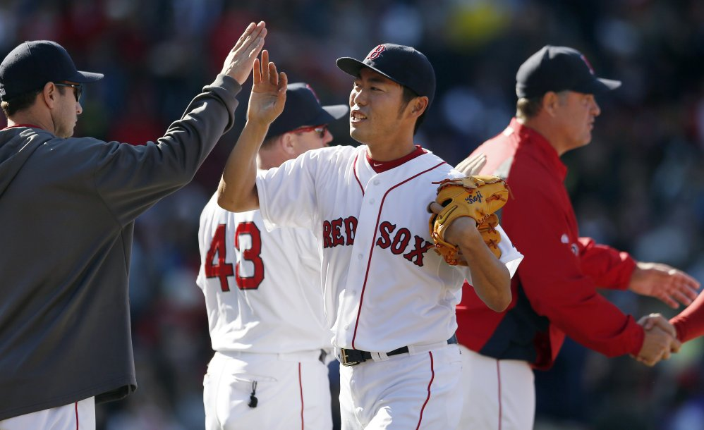 Boston Red Sox closer Koji Uehara celebrates after the team defeated the Baltimore Orioles 4-2 in Boston on Saturday.