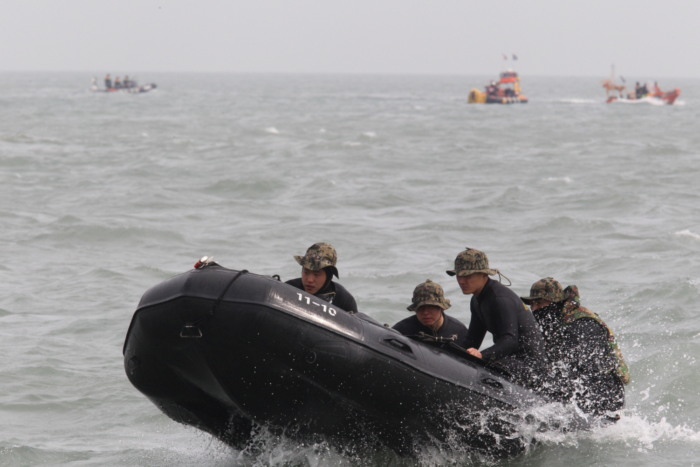 Members of the South Korean special forces set out to rescue passengers believed to have been trapped in the sunken ferry Sewol near the buoys that were installed to mark the vessel in the water off the southern coast near Jindo, South Korea, on Monday.