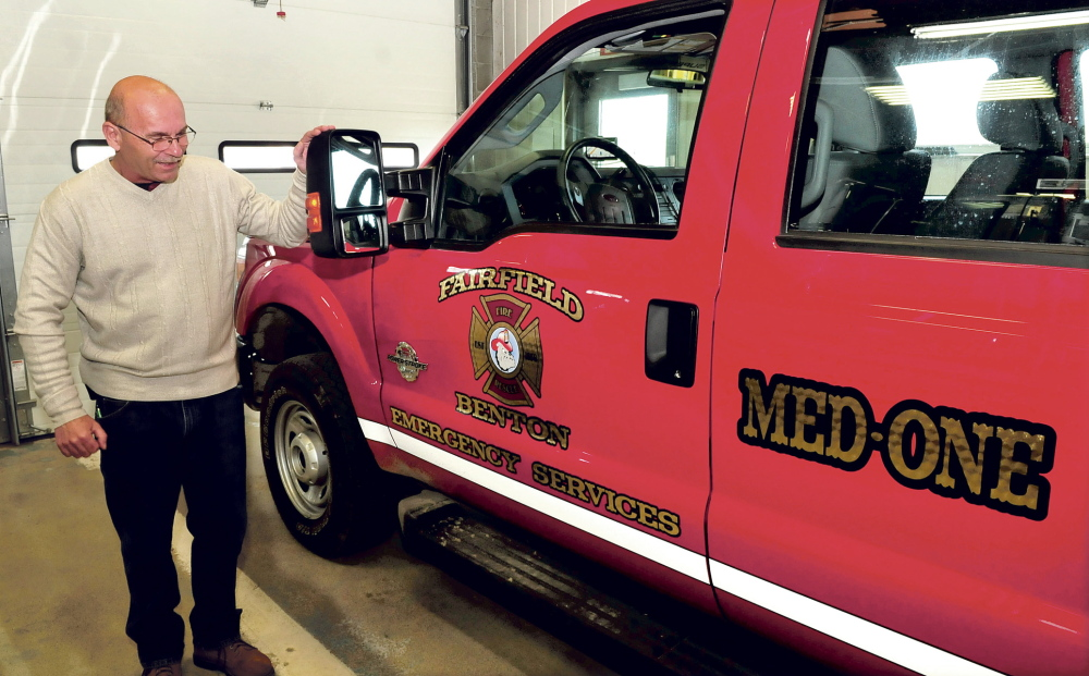 NEIGHBORS: Fairfield Fire Chief Duane Bickford looks over the new Med One truck at the department on Thursday, April 17, 2014. After helping each other fight fires for more than 100 years, Fairfield and Benton have entered into their first formal inter-local agreement under which the Fairfield Fire Department will become Fairfield-Benton Fire Rescue.
