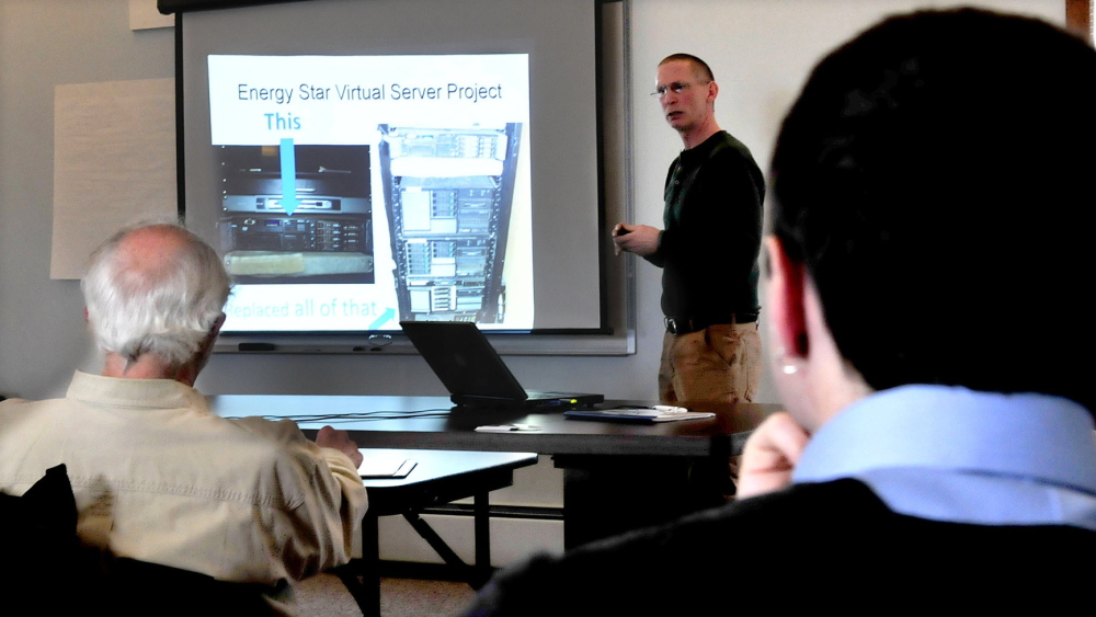 EFFICIENCY: Tim Downing, president of Duratherm Window Corp., speaks to business owners and municipal officials during an Earth Day Mid-Maine Climate Adaptation presentation on energy efficiency at Kennebec Valley Council of Governments on Tuesday.