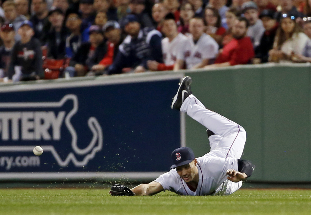 Red Sox right fielder Grady Sizemore dives but cannot catch a single by Yankees' Brian Roberts during the third inning at Fenway Park on Tuesday.