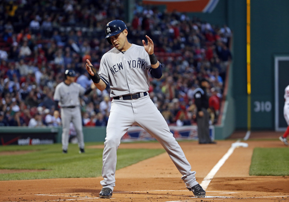 Yankees' Jacoby Ellsbury crosses home plate to score on a single by Derek Jeter during the first inning Tuesday in Boston.