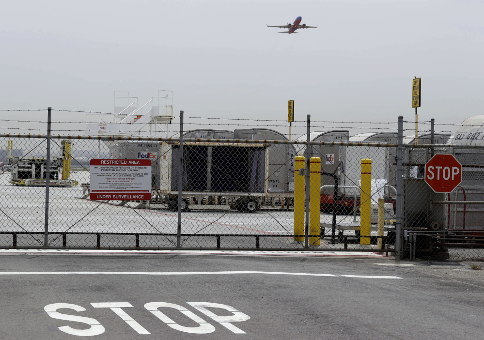 A plane takes off at Mineta San Jose International Airport Monday in San Jose, Calif., where a 16-year-old boy scrambled over a fence, crossed the tarmac and climbed into a jetliner's wheel well, then flew for five freezing hours to Hawaii on Sunday. FBI spokesman Tom Simon in Honolulu said the teen did not remember the flight from San Jose.