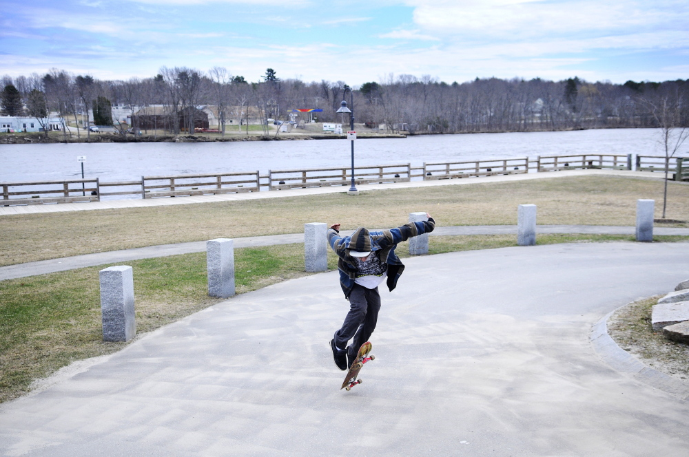 HIS ROLL IN LIFE: Chris Colby, 21, of Randolph, skateboards Monday at the area the city of Gardiner has designated for boarders along the Kennebec River.