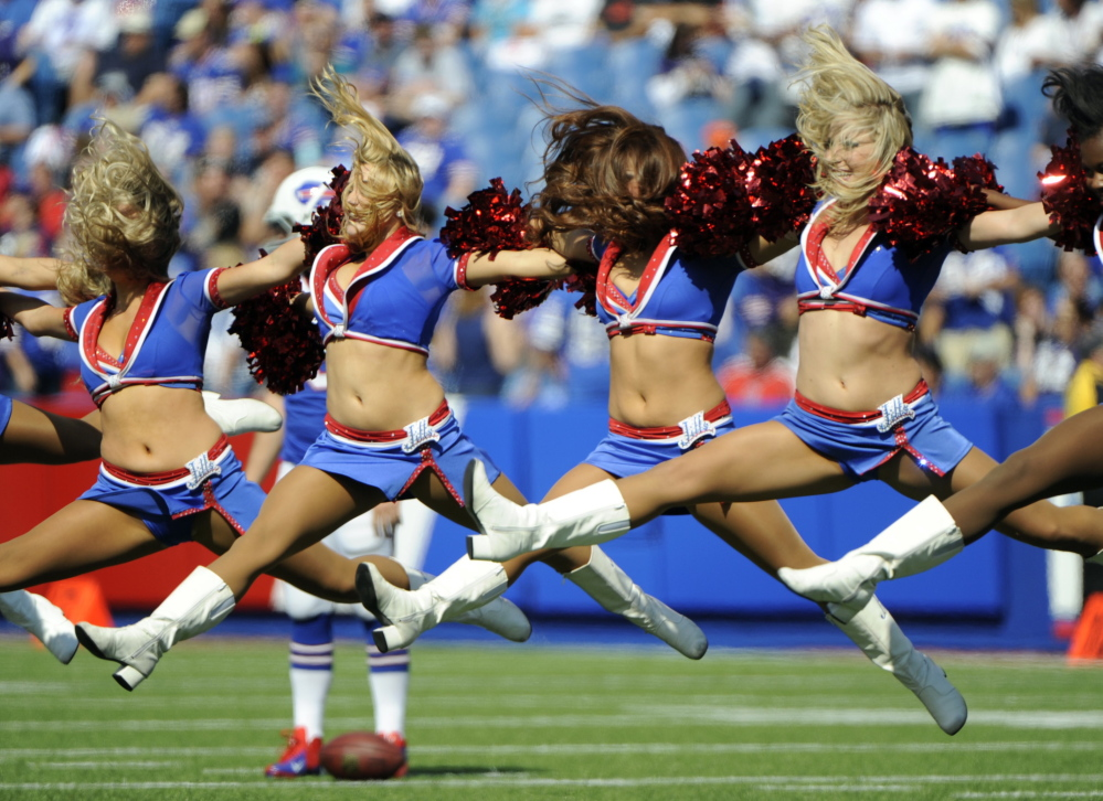 Buffalo Bills cheerleaders are shown performing during a game in 2013. Five former members of the squad have filed a lawsuit over pay.