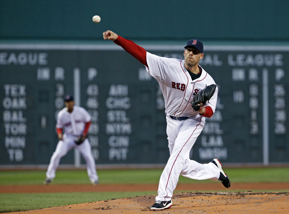 Boston Red Sox pitcher John Lackey delivers to the New York Yankees during the first inning of Wednesday's game at Fenway Park in Boston.