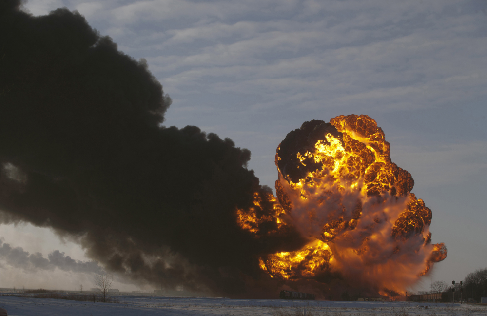 A fireball rises at the site of an oil train derailment in Casselton, N.D. The Department of Transportation is drafting new tank car regulations aimed at making the cars less likely to spill their contents in the event of a crash.