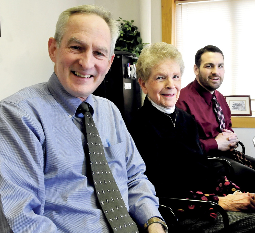 TOP BUSINESS: Tom McAdam, left, Carol Welch and Bruce Harrington of Kennebec Behavior Health speak about the organization being named Business of the Year by the Mid-Maine Chamber of Commerce.