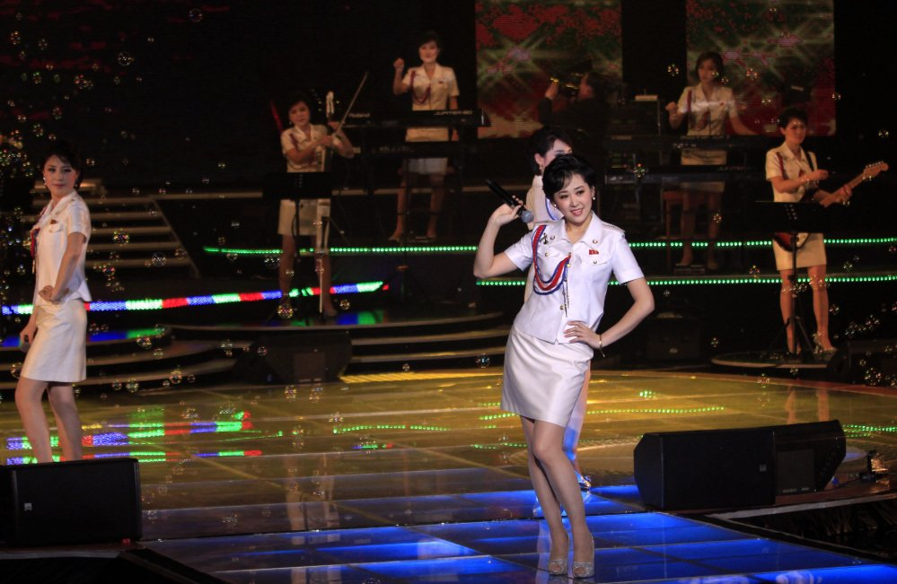 Moranbong Band singers Jong Su Hyang, foreground, and Pak Mi Kyong, left, perform in Pyongyang.