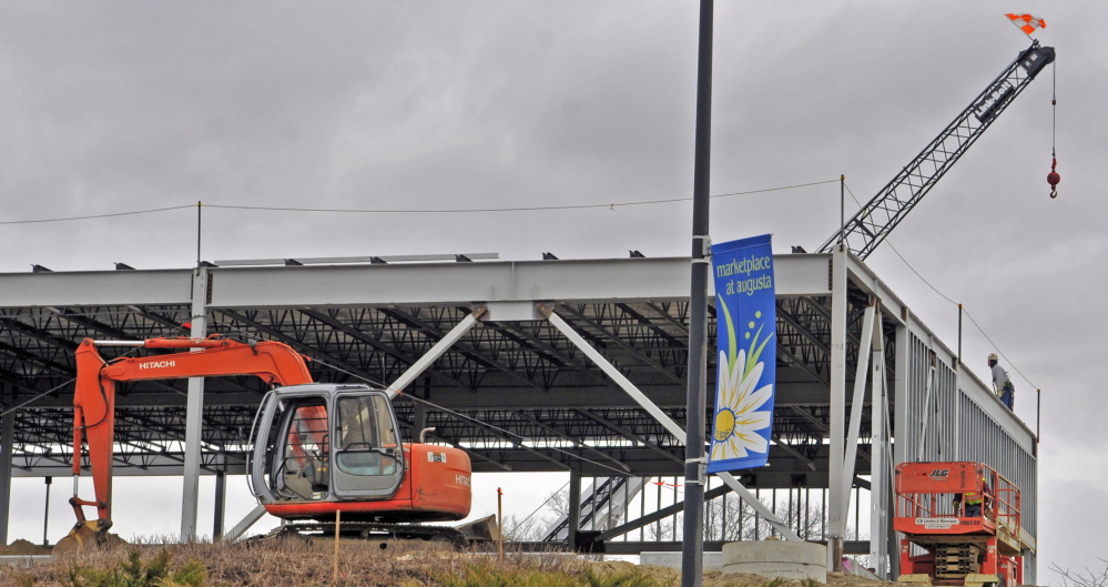 NEW DEVELOPMENT: The Marketplace at Augusta banner hangs in front of a new building under construction Thursday in Augusta.