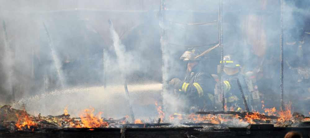 FIRE SCENE: Firefighters battle a mobile home fire at 651 Winslow Road in Albion on Friday.