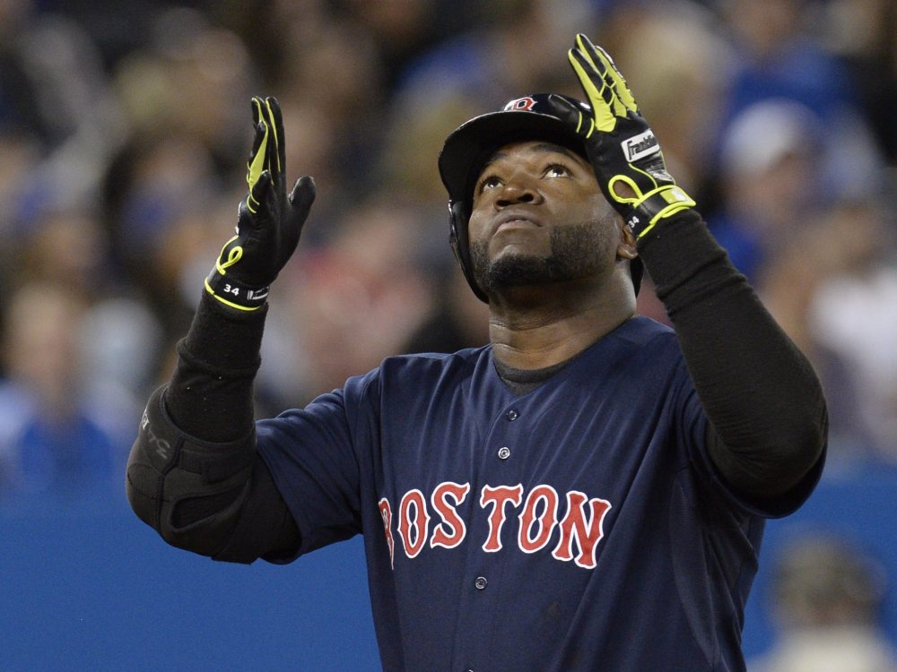 David Ortiz celebrates his solo home run as he crosses the plate during the third inning of Boston's 8-1 win Friday night over the Toronto Blue Jays.