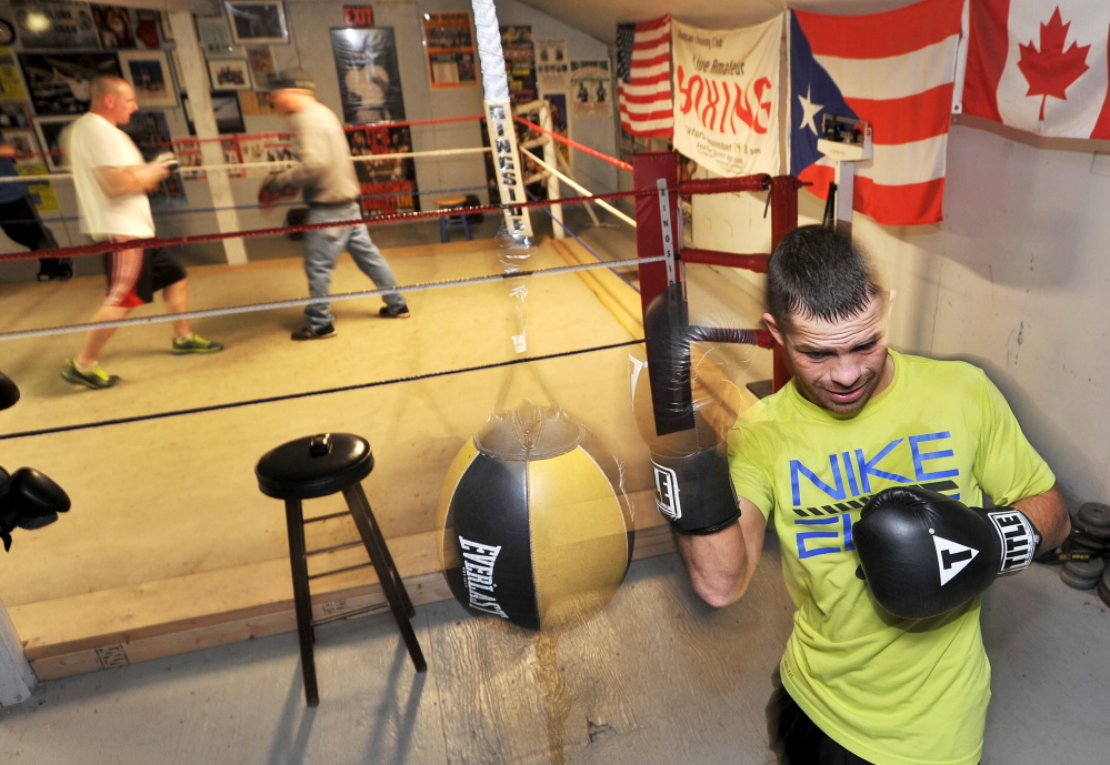 Staff photo by Michael G. Seamans UNDEFEATED: Brandon Berry works out at Wyman's Boxing Club in Stockton Springs on Wednesday. Berry is preparing for his fifth professional bout in his first year as a pro at Carabec High School on Saturday.