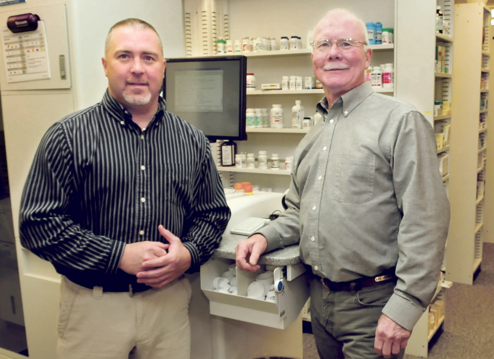 Staff photo by David Leaming BUSINESS PERSON OF THE YEAR: Shane Savage, left, and his father, Bud Savage, will receive the Business Person of the Year award from the Mid-Maine Chamber of Commerce Tuesday.