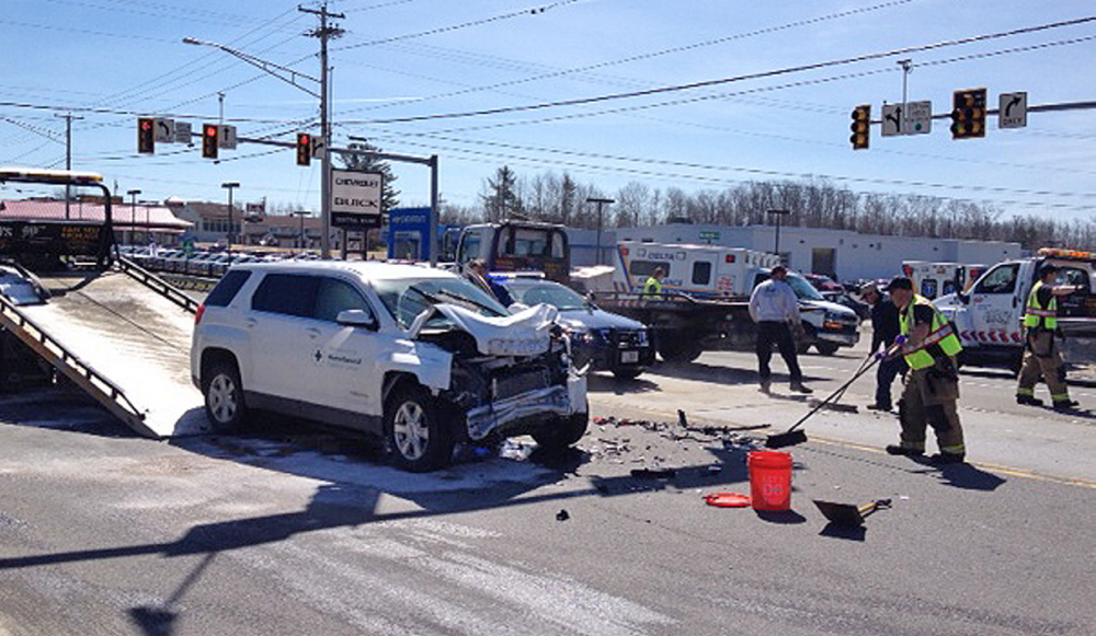 Crash: Police attend to a four-vehicle accident Friday on Kennedy Memorial Drive in Waterville in which four people suffered minor injuries.