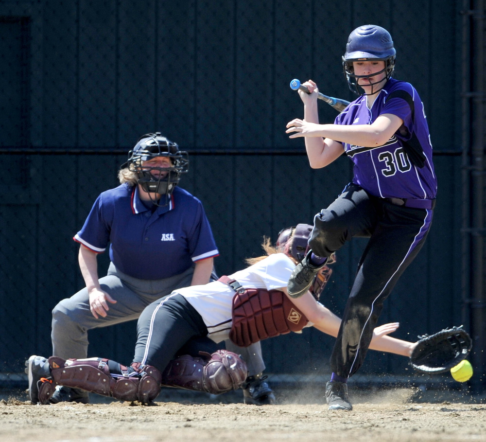 Staff photo by Michael G. Seamans Waterville Senior High School's Hannah Allen, 30, jumps out of the way from a pitch by Maine Central Institute's Jody Bickford, 21, in Waterville.