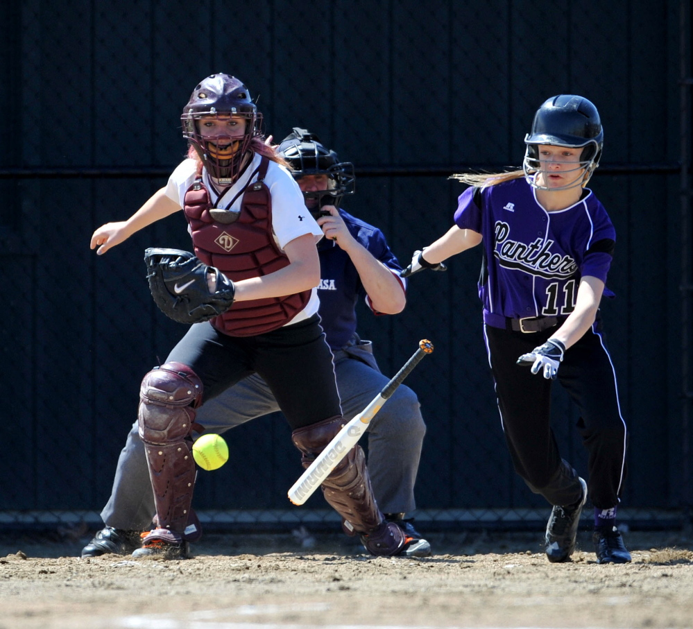 Staff photo by Michael G. Seamans Watreville Senior High School's Brooklyn LeClair, 11, lays down a bunt against Maine Central Institute in the second inning in Waterville.