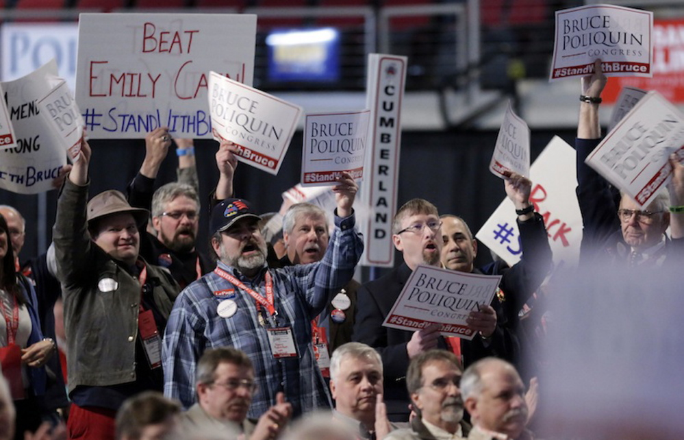Supporters of congressional candidate Bruce Poliquin cheer at the Maine GOP Convention on Saturday.